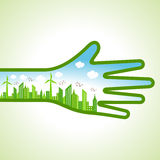 Ecology Concept - eco cityscape with hand Royalty Free Stock Photo