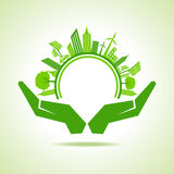 Ecology Concept - eco cityscape with hands Royalty Free Stock Photo
