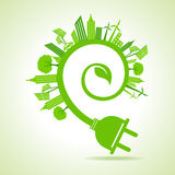 Ecology Concept - eco cityscape with leaf and electric plug Stock Photos