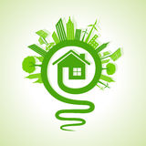 Ecology concept - eco cityscape with light-bulb and home icon Royalty Free Stock Photo