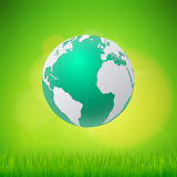 Ecology concept eco friendly and save the earth with grass. Royalty Free Stock Images