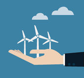 Ecology concept with hand give wind power station. Royalty Free Stock Photo