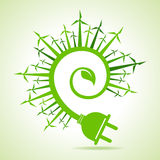 Ecology concept - Leaf and electric plug with wind mill Stock Image