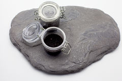 Ecology concept (little jars on a stone) Royalty Free Stock Photography