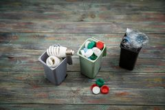 Ecology concept, a lot of recyclable objects in containers. On the wooden background Stock Photography