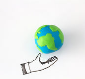 Ecology concept with modelling clay of earth globe on drawing of hand on white background Royalty Free Stock Image