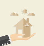 Ecology concept. Paper cut of House on hand. Vector illustration Royalty Free Stock Images