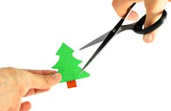 Ecology concept: paper tree being cut by scissors Royalty Free Stock Photo