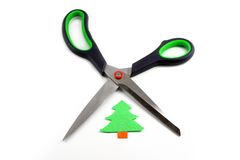 Ecology concept: paper tree being cut by scissors Royalty Free Stock Image