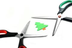 Ecology concept: paper tree being cut by scissors Royalty Free Stock Images