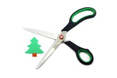 Ecology concept: paper tree being cut by scissors Royalty Free Stock Photography