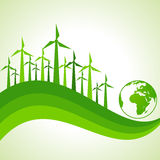 Ecology Concept - wind mill with earth Stock Photos