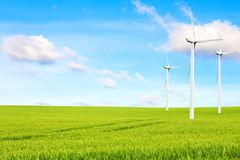Ecology concept. windmills, field and beautiful sky. Renewable energy sources.  Stock Photo