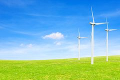 Ecology concept. windmills, field and beautiful sky. Renewable energy sources.  Stock Images