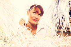 Ecology concept. Young woman with shredded paper. Focus on face Stock Photo