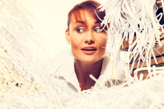 Ecology concept. Young woman with shredded paper. Focus on face Royalty Free Stock Image