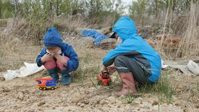 Ecology. Dump, Young children in the contaminated area together with their mother live in the future. stock video footage