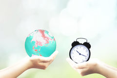 Ecology Earth Hour Spring Time. Protect the earth, the concept of time, cherish the time, exchange, give Stock Image