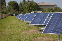 Ecology electric energy farm with solar panel battery in green f Stock Photo