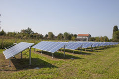 Ecology electric energy farm with solar panel battery in green f Royalty Free Stock Images