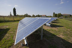Ecology electric energy farm with solar panel battery in green f Stock Photography