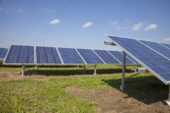 Ecology electric energy farm with solar panel battery in green f Royalty Free Stock Photography