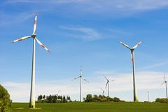 Ecology energy farm with wind turbine stock photography