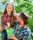 Ecology environment. soils and fertilizers. little girl and happy man dad. earth day. new life. spring village country. Ecology environment. soils and stock photo