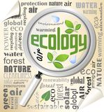 Ecology environmental theme with magnifier on typographic background Royalty Free Stock Photography