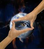 Ecology, hands, responsibility. Eye,  responsibility Stock Images