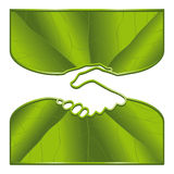 Ecology handshake. An ecological handshake with leaf surfaces Royalty Free Stock Photo