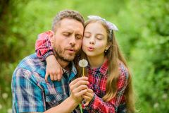 Ecology. Happy family day. spring village country. family summer farm. little girl and happy man dad. earth day. Daughter and father with dandelion flower stock images