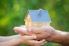 Ecology house in hands Royalty Free Stock Image