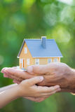 Ecology house in hands stock photos