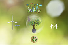 Ecology house and solar, windmill, recycle, family. Royalty Free Stock Images