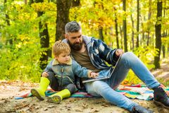 Ecology lesson. Forest school and ecology education. Man bearded father and little son with laptop in forest. Ecology stock photography