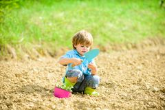 Ecology life. Cultivation concept. small kid planting a flower. earth day. new life. summer farm. farming and stock photo