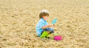 Ecology life. eco farm. human nature. earth day. new life. summer farm. small kid planting flower. happy child gardener. Ecology life. eco farm. human nature stock photo