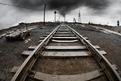 Ecology pollution. Landscape with railway,  pollution of the environment emission of  industrial plant, Karabash city;  Russia Royalty Free Stock Image