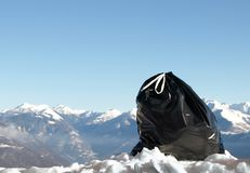 Ecology series -  garbage. Contrast - black garbage and white wiss mountains Royalty Free Stock Photos
