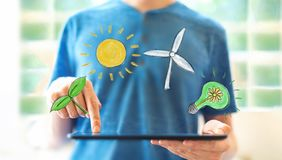 Ecology theme with man using a tablet royalty free stock photography