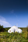 Ecology whitewash building in mountain area Stock Photography