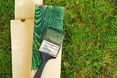 Ecology work ecologic. Ecologic work, painting wood on green, environmental concept Royalty Free Stock Photography
