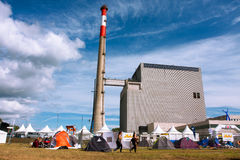 Ecologycal festival camp with the tents near the atomic power plant. Ecologycal Festival camp with the tents near the Zwentendorf Nuclear Power Plant in Austria royalty free stock image