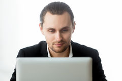 Ecommerce male entrepreneur working on laptop Royalty Free Stock Photography