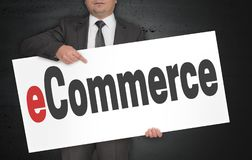 ECommerce poster is held by businessman.  Stock Image