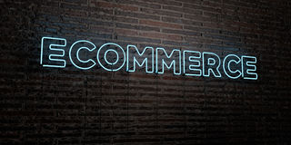 ECOMMERCE -Realistic Neon Sign on Brick Wall background - 3D rendered royalty free stock image Stock Photos