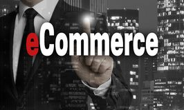 Ecommerce is shown by businessman concept.  Royalty Free Stock Images