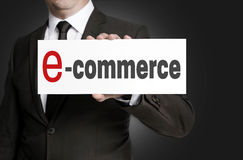 Ecommerce sign held by businessman Stock Photo