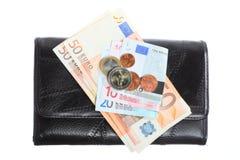 Economía y finanzas. Monedero con el billete de banco euro aislado Imágenes de archivo libres de regalías